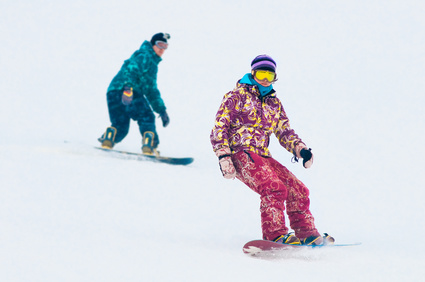 Young girl snowboarder on the board